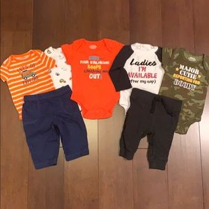 Lot of 7 newborn outfits. Onesies never worn
